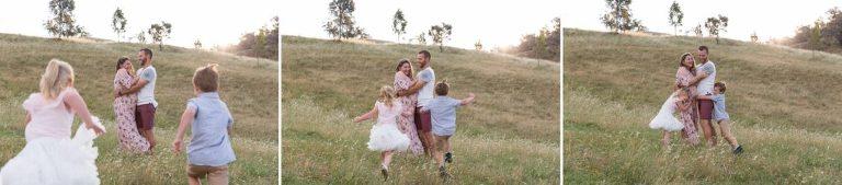 children run up to their mum and dad for a big hug