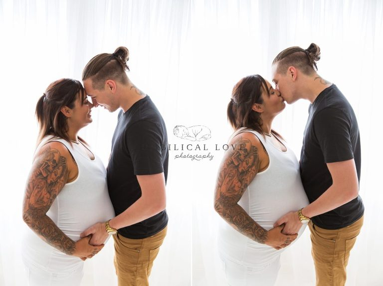 Pregnant couple cuddle with hands on belly