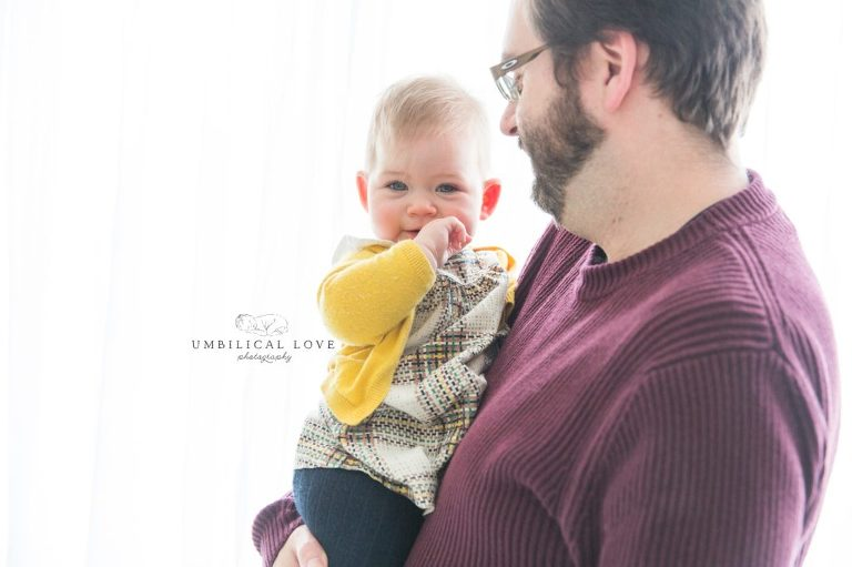 Dad hold his little girl