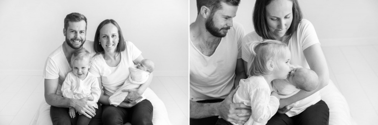 Family sits together with their newborn baby