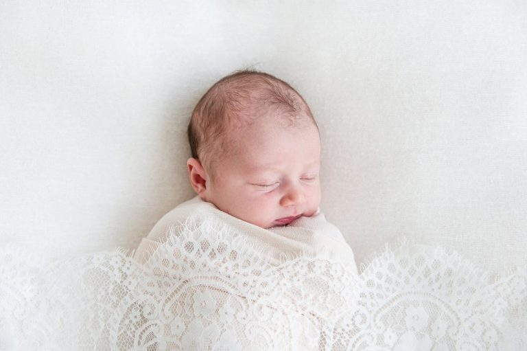 Baby sleeping wrapped up in lace