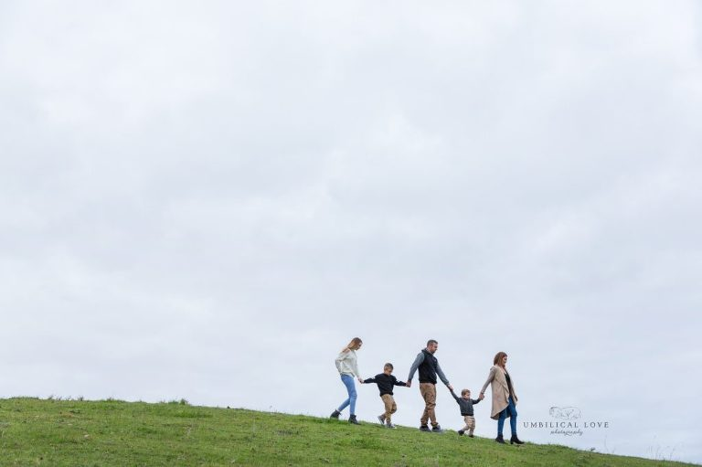 Family walking together down the hill